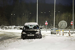 © Licensed to London News Pictures . 26/01/2013 . Wigan , UK . A car is left abandoned on a slip road beside junction 25 of the M6 in Lancashire . Drivers have been stranded in cars overnight on the M6 near Wigan after the motorway was closed following heavy snow . Photo credit : Joel Goodman/LNP