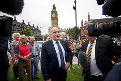 © Licensed to London News Pictures. 21/08/2017. London, UK.  MP STEPHEN POUND talking to media on Parliament Square after Big Ben chimed for the last time ahead of repair works. The Great Bell, also known as Big Ben, is expected to be silent for up to four years as renovation work is carried out on the surrounding Elizabeth Clock Tower. The worlds most famous clock has sounded on the hour for 157 years and last fell silent for maintenance work in 2007. Photo credit: Ben Cawthra/LNP