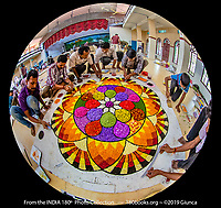 Contestants creating a Pookalam