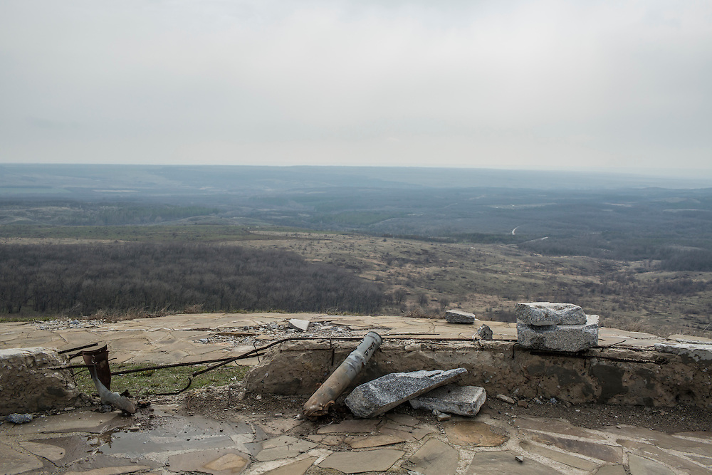 A part of a rocket is left on top of the monument at Saur Mogila on Thursday, March 24, 2016 in Saurivka, Ukraine. The monument commemorates the scene of a battle during World War II and was also the site of heavy fighting during the war in Eastern Ukraine.
