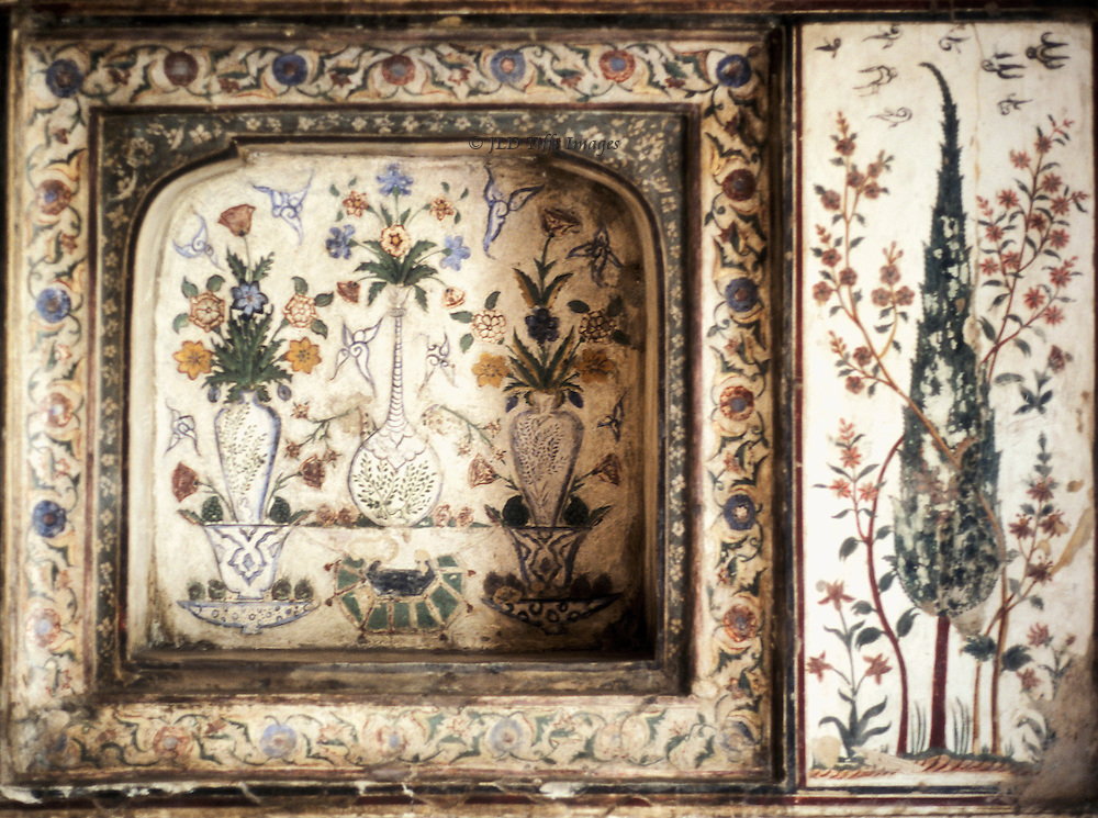 Wall panel in the Itimad ud Daulah tomb, Agra, with painted floral and arboreal decoration on marble..