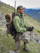 Successful Dall Sheep Hunter Packing Out a Ram in Alaska.