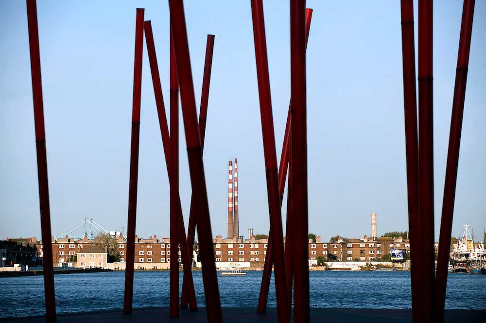 The regenerated Grand Canal basin in Dublin's docklands area with the Poolbeg chimneys in the background.