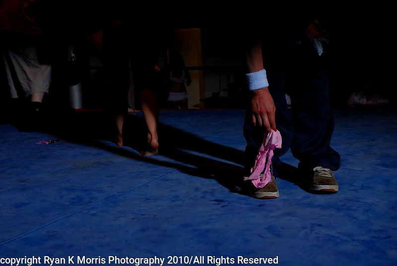 "Invited guests attend a ""catfighting"" match at a Naples, FL boxing gym. The event, held on the eve of Easter, had celebrity porn star Ron Jeremy as MC. The closed event advertised on Craigslist looking for women to be part of a catfighting DVD production shoot with a live audience. This selection of images is part of a larger project documenting the increased acceptance of pornography and the everyday entertainment habits of Americans..Photos by Ryan K. Morris Photography"