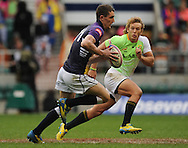 LONDON, ENGLAND - Saturday 10 May 2014, Werner Kok of South Africa chases Lewis Young of Scotland during the match between South Africa and Scotland at the Marriott London Sevens rugby tournament being held at Twickenham Rugby Stadium in London as part of the HSBC Sevens World Series.<br /> Photo by Roger Sedres/ImageSA