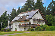 farm house with solar panels. photographed in the black forest region, Germany in July