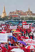 """Mar. 26, 2009 -- BANGKOK, THAILAND: The crowd of Red Shirts in front of the Royal Palace in Bangkok. More than 30,000 members of the United Front of Democracy Against Dictatorship (UDD), also known as the """"Red Shirts,""""  and their supporters descended on central Bangkok Thursday to protest against and demand the resignation of current Thai Prime Minister Abhisit Vejjajiva and his government. Abhisit was not at Government House Thursday. The protest is a continuation of protests the Red Shirts have been holding across Thailand in March.  Photo by Jack Kurtz"""
