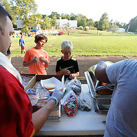 Thomas Wells | Buy at PHOTOS.DJOURNAL.COM<br /> Clay Hewitt, 10, lcenter left, and his cousin,  Jack Capps, 9, get a hamburger during Wednesday's Festival on the Field at Robins Field in Tupelo. The event was hosted by First United Methodist, First Presbyterian, All Saint Episcopal and St. Paul United Methodist Church.