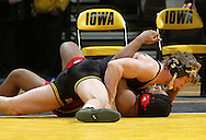 Iowa's Grant Gambrall pins Southern Illinois Edwardsville's Deshoun White during the 184-pound bout of their dual at Carver-Hawkeye Arena, 1 Elliot Drive in Iowa City on Friday evening January 7, 2010. Gambrall pinned White in 2:28 and Iowa defeated Southern Illinois Edwardsville 49-0.