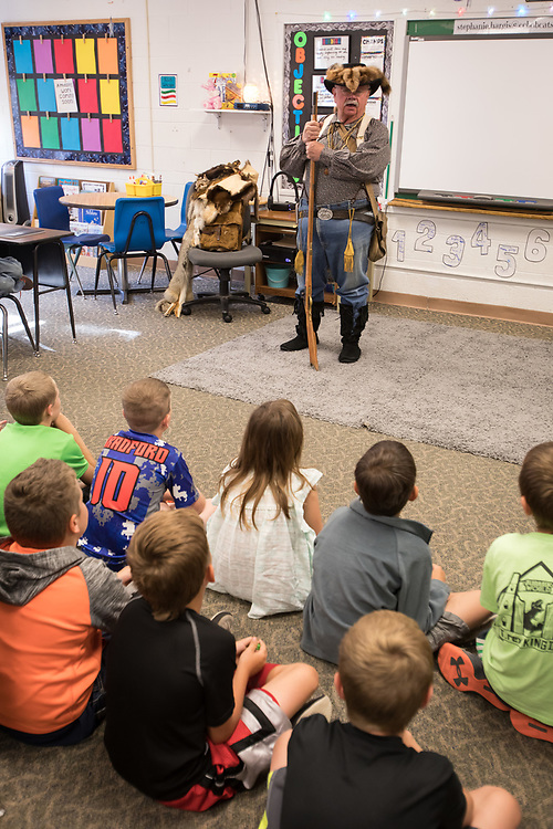 """Bear Claw,"" aka Don Moon, portrays and explains the life of an 18th Century mountain man to students at Custer County Schools."