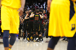 April 25, 2018 - Cleveland, OH, USA - Cleveland Cavaliers forward LeBron James is mobbed by teammates after scoring the game-winning 3-point shot against the Indiana Pacers in the fourth quarter of Game 5 on Wednesday, April 25, 2018, at Quicken Loans Arena in Cleveland. The Cleveland Cavaliers won, 98-95, for a 3-2 lead in the first-round NBA playoff series. (Credit Image: © Leah Klafczynski/TNS via ZUMA Wire)