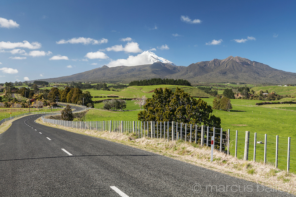 Road winding through fields, Taranaki, New Zealand