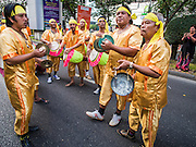 "14 JANUARY 2015 - BANGKOK, THAILAND: Traditional drummers perform in the 2015 Discover Thainess parade. The Tourism Authority of Thailand (TAT) sponsored the opening ceremony of the ""2015 Discover Thainess"" Campaign with a 3.5-kilometre parade through central Bangkok. The parade featured cultural shows from several parts of Thailand. Part of the ""2015 Discover Thainess"" campaign is a showcase of Thailand's culture and natural heritage and is divided into five categories that match the major regions of Thailand – Central Region, North, Northeast, East and South.     PHOTO BY JACK KURTZ"