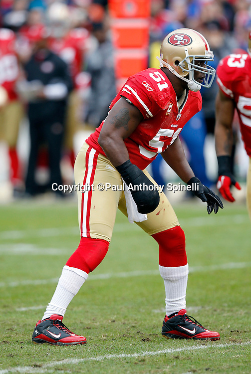 San Francisco 49ers linebacker Takeo Spikes (51) gets set for the snap while wearing a large wrap around his right hand and wrist during the NFL week 17 football game against the Arizona Cardinals on Sunday, January 2, 2011 in San Francisco, California. The 49ers won the game 38-7. (©Paul Anthony Spinelli)