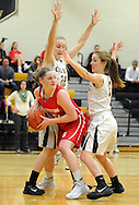Souderton's Mia Sherer (center) as Central Bucks West's Makenzie Mason (22) and Abby Spratt (right) defend in the first quarter at Central Bucks West Friday December 18, 2015 in Doylestown, Pennsylvania. (Photo by William Thomas Cain)