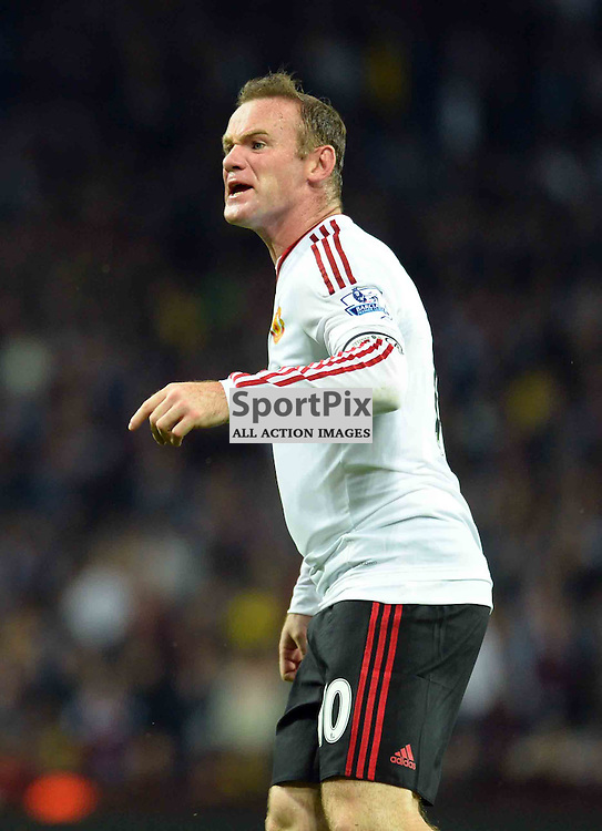 Manchester United captain Wayne Rooney shouts in protest at the linesman