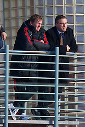 LIVERPOOL, ENGLAND - Tuesday, January 11, 2011: Liverpool's new manager Kenny Dalglish watches the reserve side in action against Sunderland with club secretary Ian Sylvester during the FA Premiership Reserves League (Northern Division) match at the Kirkby Academy. (Pic by: David Rawcliffe/Propaganda)