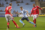 Coventry city midfielder, on loan from Liverpool, Ryan Kent   goes past Barnsley defender Reece Wabara  to score  during the Sky Bet League 1 match between Coventry City and Barnsley at the Ricoh Arena, Coventry, England on 3 November 2015. Photo by Simon Davies.