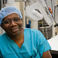 Surgeon in front of Davinci robot in Olympia, WA, hospital photography, commercial photography, Tucson Photographer