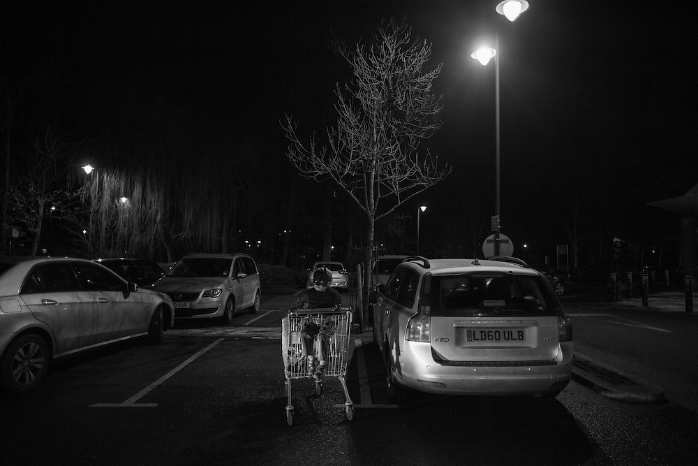 Ben and Joe wait in a supermarket cart in the parking lot next to our Volvo estate after a late run to the local Waitrose store in Berkhamsted in England Tuesday, Feb. 3, 2015 (Elizabeth Dalziel) #thesecretlifeofmothers #bringinguptheboys #dailylife