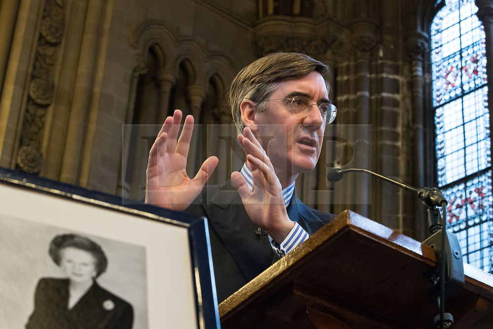 © Licensed to London News Pictures . 02/10/2017. Manchester, UK. JACOB REES-MOGG and a framed portrait of Margaret Thatcher , speaking at a fringe , right-wing Bruges Group event at Manchester Town Hall during the second day of the Conservative Party Conference at the Manchester Central Convention Centre . Photo credit: Joel Goodman/LNP