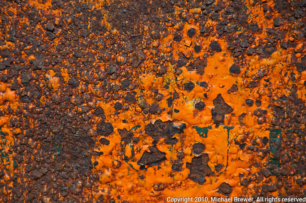 Gorgeous orange and rust texture on a sign  on a Camargue, France beach.