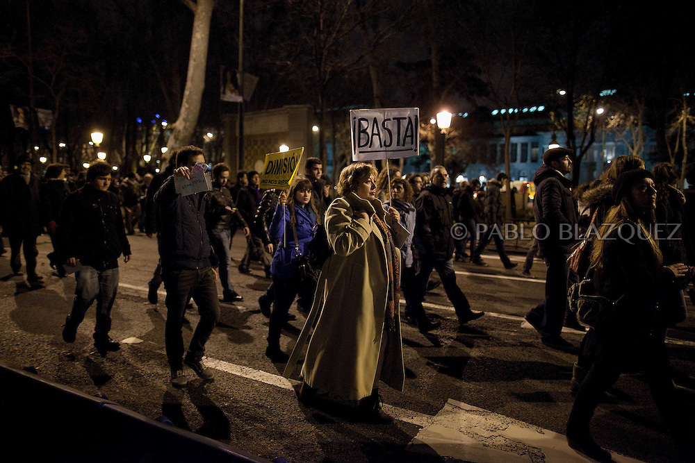 Protesters walk in the street during a demonstration against political corruption and claiming Mariano Rajoy to resign in Madrid on February 1, 2013. The Spanish Newspaper 'El Pais' published secret papers of income implicating Spanish Prime Minister and other members of the PP (Popular Party). Rajoy's government has denied these secret payments.