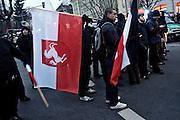 Dresden | 19.11.2011..Neonazis aus ganz Deutschland und aus anderen Ländern Europas planten in Dresden wie in den vergangenen Jahren eine Demonstration (Trauermarsch), um an die Bombardierung Dresdens am 13.02.1945 zu erinnern. Der Tag entwickelte sich für die Neonazis zum Fiasko, über 20000 Demonstranten verhinderten mit Mahnwachen, Demonstrationen und Blockaden die Demo-Versuche der Neonazis..Hier: Neonazis haben sich im Dresdner Ortsteil Plauen versammelt, einige nehmen zu einem vergeblichen Demo-Versuch mit ihren Fahnen Aufstellung..©peter-juelich.com..[No Model Release | No Property Release]