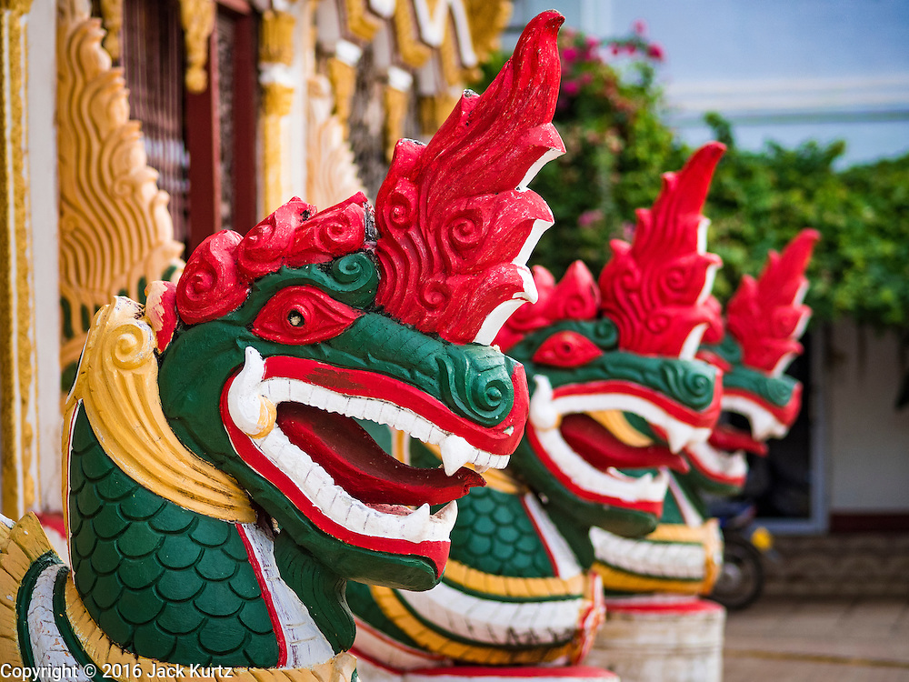 16 JUNE 2016 - PAKSE, CHAMPASAK, LAOS: Nagas, or mystical snakes that guard holy places, in front of Wat Luang, the largest Buddhist temple in Pakse, Laos. Pakse is the capital of Champasak province in southern Laos. It sits at the confluence of the Xe Don and Mekong Rivers. It's the gateway city to 4,000 Islands, near the border of Cambodia and the coffee growing highlands of southern Laos.      PHOTO BY JACK KURTZ