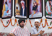 The portraits of spiritual teachers (Gurus) of Sikhism are exposed on a carriage during the procession.