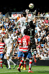 05.04.2015, Estadio Santiago Bernabeu, Madrid, ESP, Primera Division, Real Madrid vs FC Granada, 29. Runde, im Bild Real Madrid´s Cristiano Ronaldo and Granada´s goalkeeper Oier Olazabal // during the Spanish Primera Division 29th round match between Real Madrid CF and Granada FC at the Estadio Santiago Bernabeu in Madrid, Spain on 2015/04/05. EXPA Pictures © 2015, PhotoCredit: EXPA/ Alterphotos/ Luis Fernandez<br /> <br /> *****ATTENTION - OUT of ESP, SUI*****