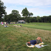 A spectator rests near the 11th fairway during the third round of theThe Barclays Golf Tournament at The Ridgewood Country Club, Paramus, New Jersey, USA. 23rd August 2014. Photo Tim Clayton
