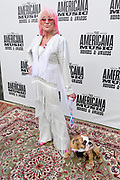 NASHVILLE, TENNESSEE - SEPTEMBER 11: Tanya Tucker and puppy Stella Quaid arrive at the 18th Annual Americana Honors & Awards at Ryman Auditorium on September 11, 2019 in Nashville, Tennessee.