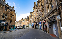 Edinburgh, Scotland, UK. 29 March, 2020. Life in Edinburgh on the first Sunday of the Coronavirus lockdown. Streets deserted, shops and restaurants closed, very little traffic on streets and reduced public transport. Pictured; Cockburn Street. Iain Masterton/Alamy Live News