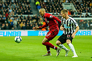 Fabinho (#3) of Liverpool shields the ball from Matt Ritchie (#11) of Newcastle United during the Premier League match between Newcastle United and Liverpool at St. James's Park, Newcastle, England on 4 May 2019.