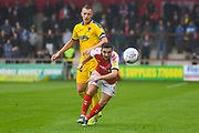 Joe Pigott of AFC Wimbledon (39) and Lewis Coyle of Fleetwood Town (2) in action during the EFL Sky Bet League 1 match between Fleetwood Town and AFC Wimbledon at the Highbury Stadium, Fleetwood, England on 10 August 2019.