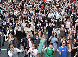 © Licensed to London News Pictures. 11/10/2015. London, UK. Strictly Come Dancing's assistant Charleston choreographer Scott Cupit (2nd row) joins volunteers rehearsing an attempt to break the world record for the largest number of people dancing the Charleston at Spitalfields. Photo credit: Peter Macdiarmid/LNP