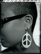 Asian woman with peace sign earrings. (Photo: Ann Summa).