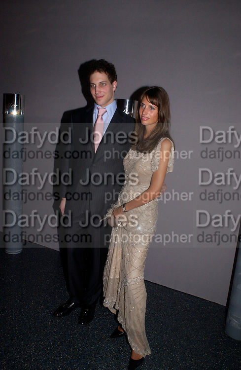 Lord Frederick Windsor and Marina Hanbury, Party to celebrate 100 years of the Santos  de Cartier watch. Le Bourget airport. Paris. 7 April 2004. ONE TIME USE ONLY - DO NOT ARCHIVE  © Copyright Photograph by Dafydd Jones 66 Stockwell Park Rd. London SW9 0DA Tel 020 7733 0108 www.dafjones.com