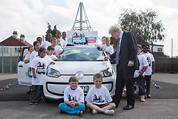 "© licensed to London News Pictures. London, UK 14/06/2012. Boris Johnson signing the ""Peace Car"" at Cooper's Lane Primary School today (14/06/12). The car is the symbol of 100 Days of Peace initiative organised by Margaret Mizen and Grace Idowu whose teenage son were murdered. Photo credit: Tolga Akmen/LNP"