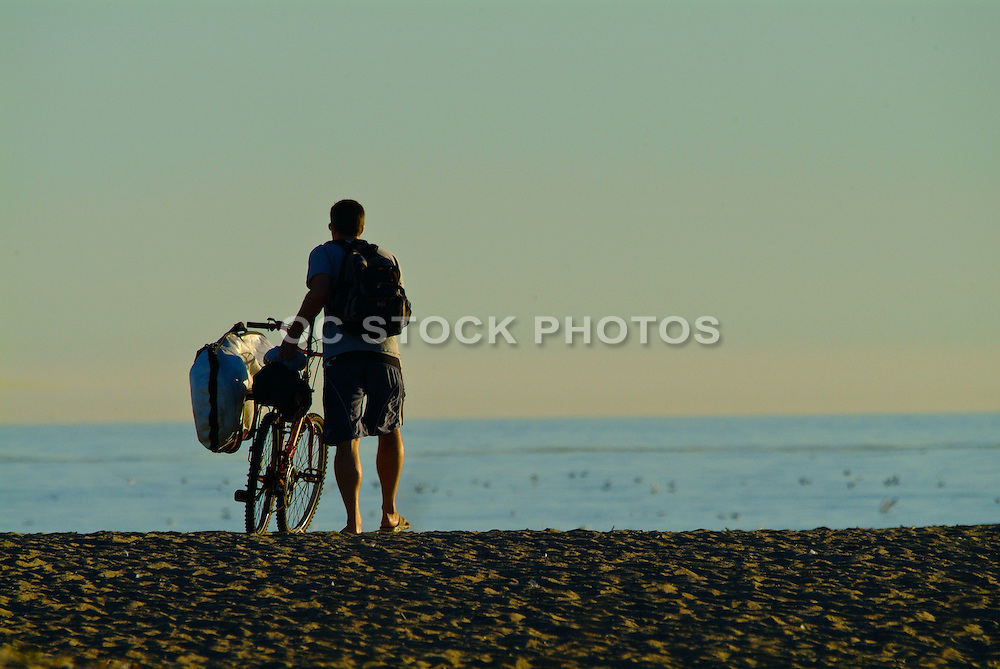 Surfer On The Beach With Bike