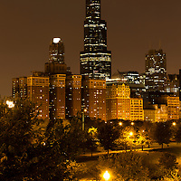 Chicago skyline at night with Willis Tower (formerly Sears Tower) building and Grant Park in the foreground.
