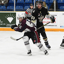 TRENTON, ON  - MAY 4,  2017: Canadian Junior Hockey League, Central Canadian Jr. &quot;A&quot; Championship. The Dudley Hewitt Cup. Game 6 between Trenton Golden Hawks and the Dryden GM Ice Dogs. Garett Graham #26 of the Dryden GM Ice Dogs and James Thomson #33 of the Trenton Golden Hawks follow the play during the first period.<br /> (Photo by Andy Corneau / OJHL Images)
