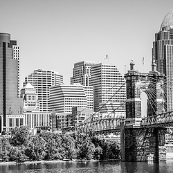 Cincinnati with Roebling Bridge black and white picture. Photo includes Cincinnati skyline, John A. Roebling bridge, and downtown city office buildings with Great American Insurance Group Tower, Omnicare building, and Scripps Center building. Photo was taken in July 2012.