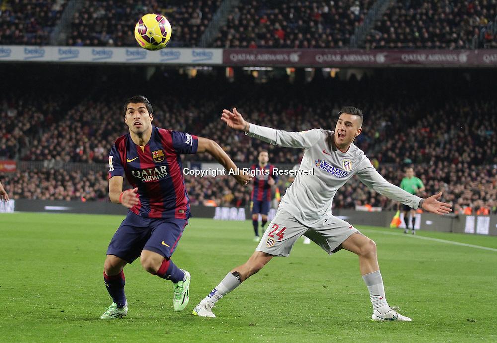 11.01.2015. Barcelona, Spain. La liga football. Barcelona versus Atletico Madrid. Suarez in action challenged by J.M. Jimenez (R)