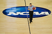 A ref walks on the court before tipoff of the NCAA South Regionals between the University of Michigan Wolverines and the University of Kansas Jayhawks at Cowboys Stadium in Arlington on Friday, March 29, 2013. (Cooper Neill/The Dallas Morning News)