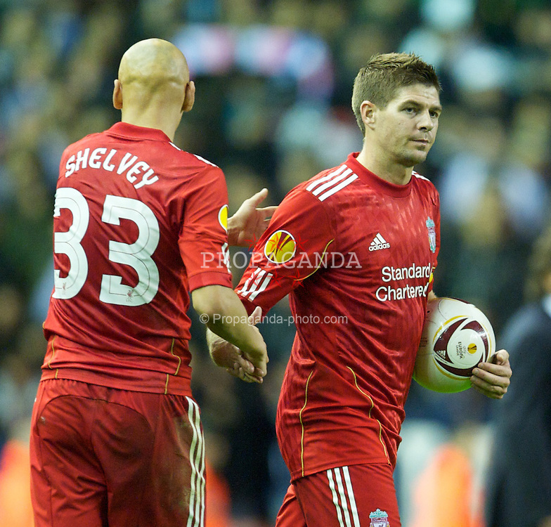 LIVERPOOL, ENGLAND - Thursday, November 4, 2010: Liverpool's hat-trick hero captain Steven Gerrard MBE grabs the match-ball after his three goals sealed a 3-1 victory over SSC Napoli during the UEFA Europa League Group K Matchday 4 match at Anfield. (Photo by David Rawcliffe/Propaganda)