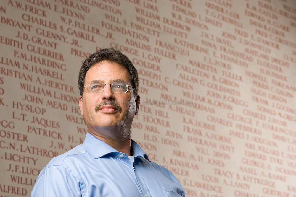 Larry Diamond, Stanford Hoover Institute. Background is a mural of the original contributors of the Hoover Institute.