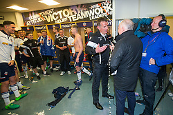 Free to use courtesy of Sky Bet - Bolton Wanderers players spray champage at Bolton Wanderers manager Phil Parkinson as they celebrate after finishing the season as Sky Bet League One runners up to secure automatic Promotion to the 2017/18 Sky Bet Championship - Rogan Thomson/JMP - 30/04/2017 - FOOTBALL - Macron Stadium - Bolton, England - Bolton Wanderers v Peterborough United - EFL Sky Bet League One.