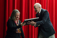 Amy Cantin LHS Class of 1986 receiving her Hall of Fame plaque from David Rae during LHS Hall of Fame Induction Ceremony on Saturday evening.  (Karen Bobotas/for the Laconia Daily Sun)